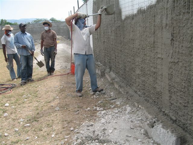 building a stucco wall with emmedue vertical concrete panels