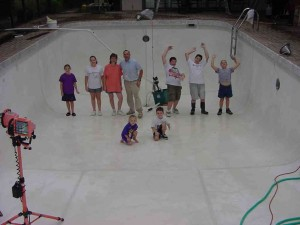 The family crew and the finished stucco pool