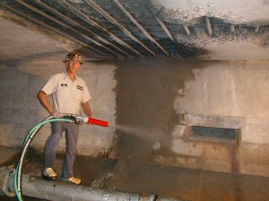 Ray Mcnair sprays dry processed gunite