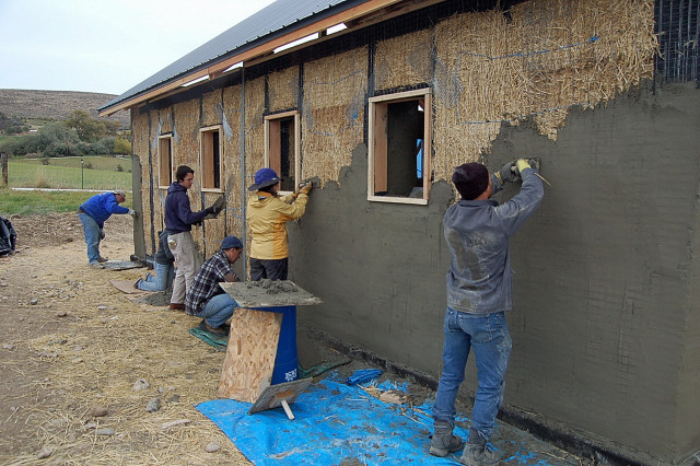 Plastering a Straw Bale House