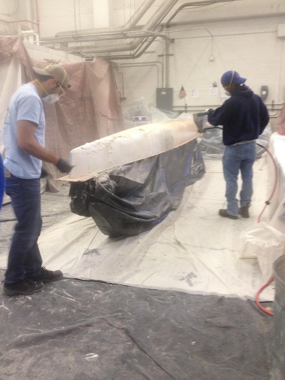 concrete canoe pour with mortar sprayer 1